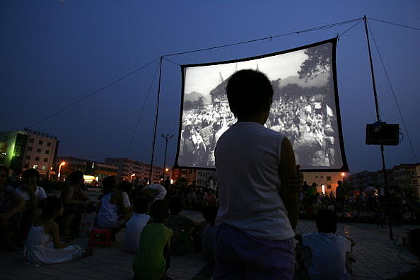 People Watch Open-air Movie During a Threat of Earthquake